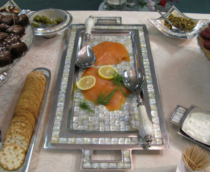 "Serving Smoked Salmon on 25"" Handled All Mother of Pearl Tray"